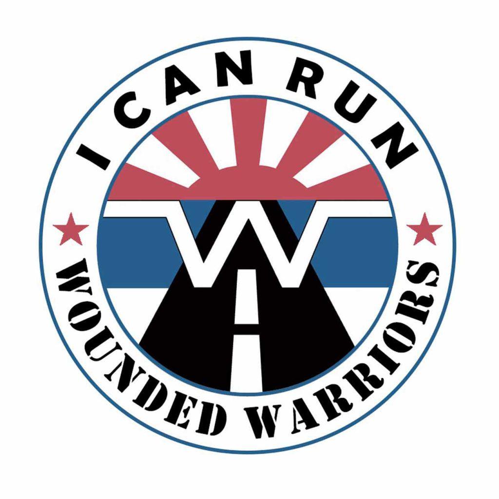 rond logo voor wounded warriors met weg en zon en grote letter w in rood wit blauw en zwart