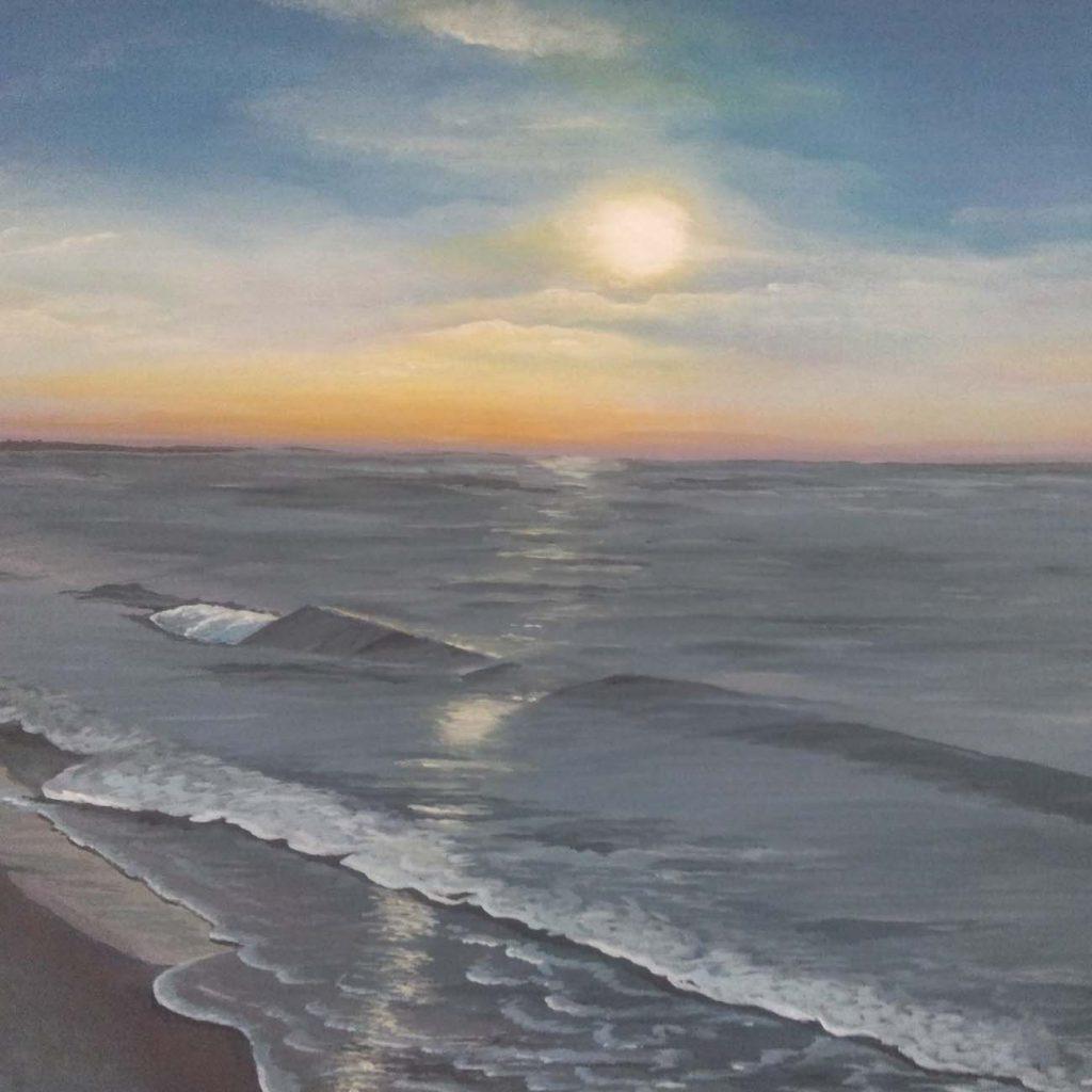 zee tafereel met een ondergaande zon